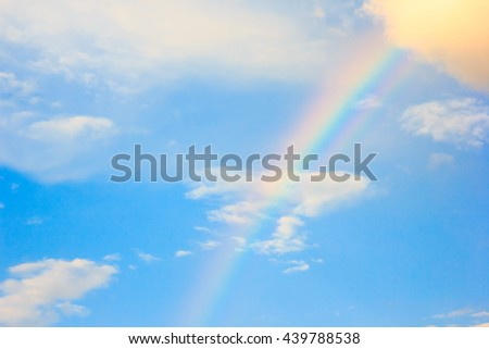 rainbow, sky with clouds and sun #439788538