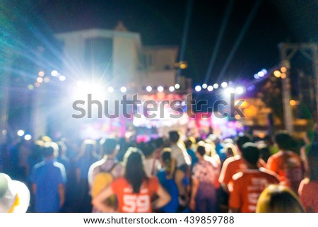 Blurred rock and roll concert movement of happy people and light fun background #439859788
