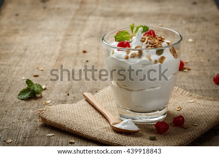 Homemade yogurt with granola copy space, dried fruit and nuts bio with most healthy seed. #439918843