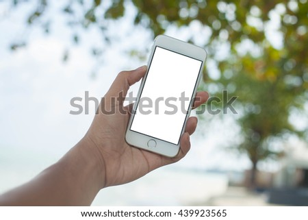 hand holding smartphone white background for text conserve nature . sky background Ecology concept. World Environment Day concept #439923565