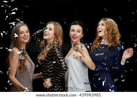 party, holidays, nightlife and people concept - happy young women dancing at night club disco over black background #439983985