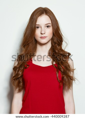 The young red-haired girl with different emotions on a white background