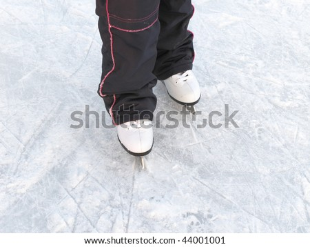 The image of child legs with figure skates #44001001