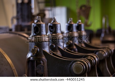 Vintage mining winch empowered by steam engine.Pistols and valves. Royalty-Free Stock Photo #440051245