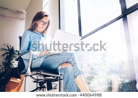 Hipster Girl use Laptop huge Loft Studio.Student Researching Process Work.Young Business Woman Working Creative Startup modern Office.Analyze market stock,new strategy.Blurred,film effect.Horizontal Royalty-Free Stock Photo #440064988