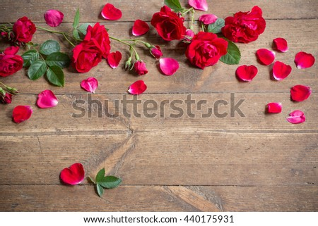 Red roses on wooden background. #440175931
