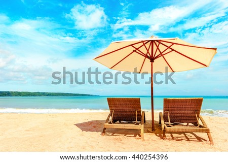 Beautiful Hawaii beach. Chairs on the  sandy beach near the sea. Summer holiday and vacation concept. #440254396