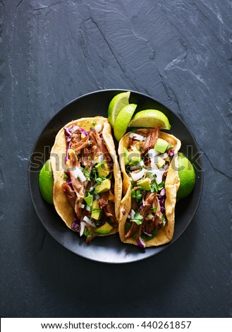 top down photo of two Mexican carnitas tacos on place in flat lay composition #440261857