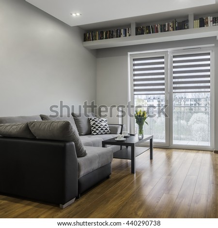 Grey sofa and coffee table in bright apartment relaxing space #440290738