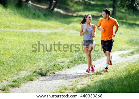 Beautiful couple jogging in nature living healthy #440330668