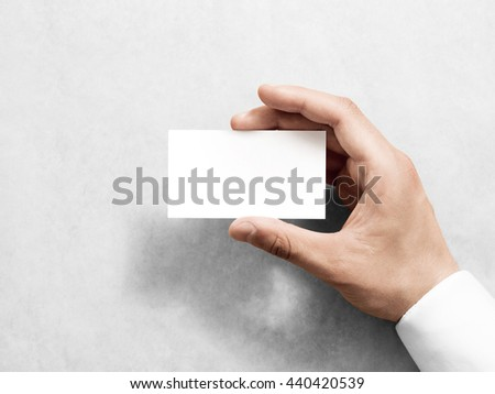 Hand holding blank plain white business card design mockup. Clear call id card mock up template hold arm. Visit pasteboard paper surface display front. Small pure offset namecard print. Logo branding