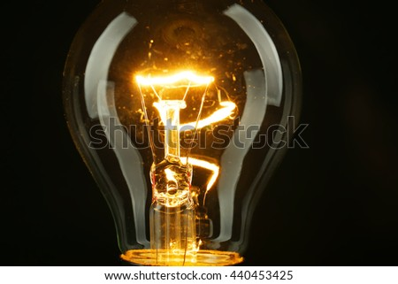 Illuminated light bulb on black background #440453425