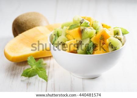 bowl of fresh healthy fruit salad, mango and kiwi #440481574