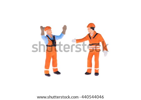 Close up of Miniature people in engineer and worker occupation isolate on white background
