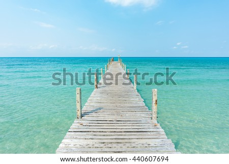 Wooden bridge to the ocean #440607694