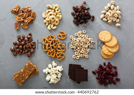 Variety of healthy snacks overhead shot laying on the table Royalty-Free Stock Photo #440692762