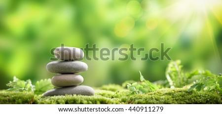 Stack of zen stones on nature background
