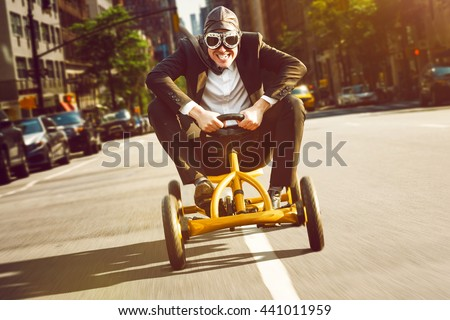 Businessman on a pedal car Royalty-Free Stock Photo #441011959
