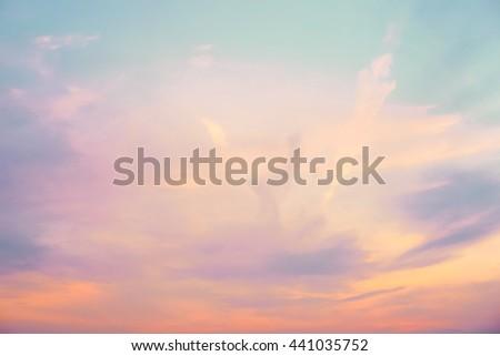 pastel colored skyscape - orange, purple, blue, and white #441035752