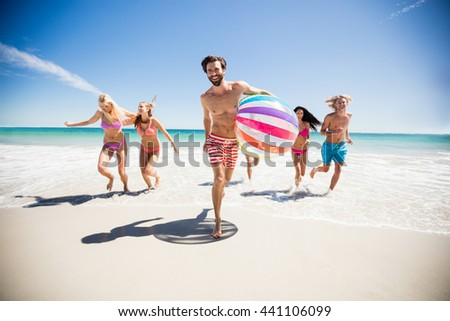 Friends having fun at the beach on a sunny day #441106099
