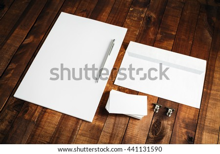 Photo of blank letterhead, business cards, envelope and pen on vintage wooden background. Blank stationery and corporate identity template. Mock-up for branding identity. #441131590
