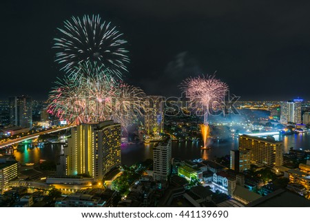Bangkok cityscape, View high building at the Chaophraya river with fireworks in the Festival. #441139690
