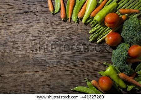 green vegetables on wood background #441327280