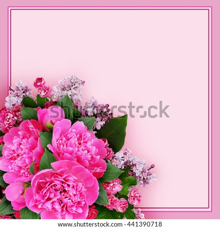 Pink peony, hawthorn and lilac flowers bouquet in a corner on pink background #441390718