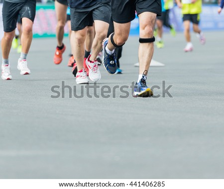 Group of marathon runners compete in the race #441406285