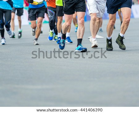 Group of marathon runners compete in the race #441406390