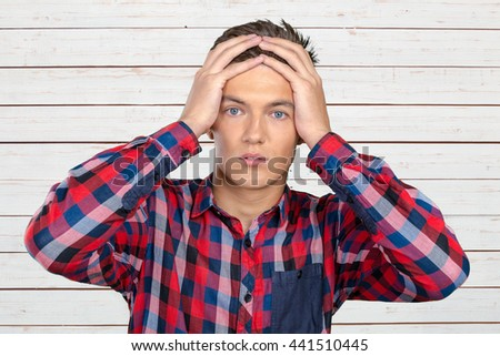 Closeup stressed young man #441510445