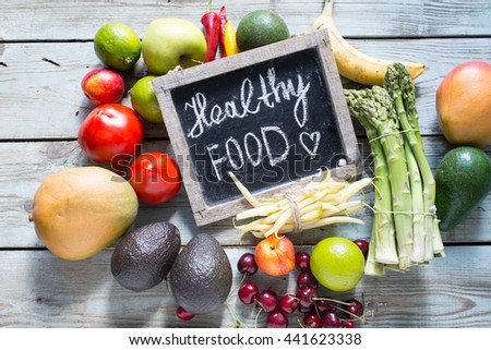 Variety of vegetables and fruits on rustic background, top view, horizontal border. Vegan food or diet eating concept. #441623338