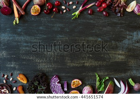 Purple toned fruit and vegetables fresh produce on dark distressed background, plenty of copy space design element for poster, book covers, recipes, website #441651574
