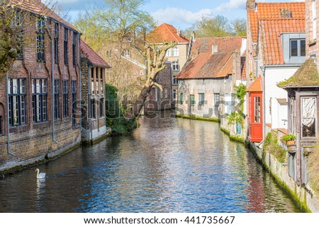 Houses and canals in Bruges, Belgium, Europe #441735667