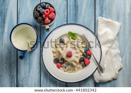 Fresh and homemade dumplings with berry fruits #441802342