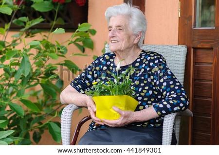 Happy senior woman sitting outside #441849301