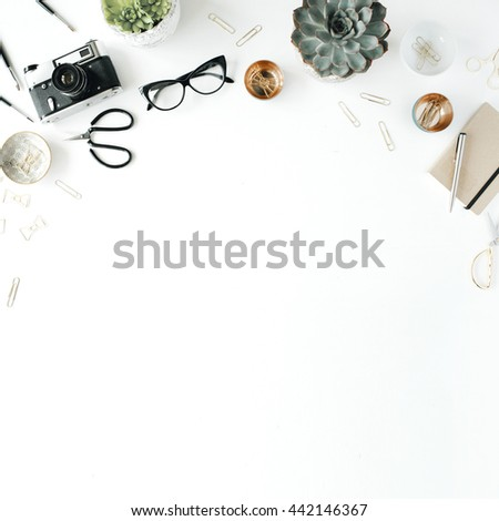 feminini desk workspace with succulent, retro camera, scissors, diary, glasses and golden clips on white background. flat lay, top view #442146367