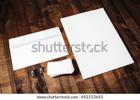 Blank letterhead, business cards and envelope. Photo of blank stationery set on vintage wooden table background. Mockup for design portfolios. Blank template for branding identity. #442153645