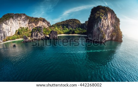 Island with a sandy beach and huge rocky cliff in the Andaman sea. The island of Koh Hong #442268002