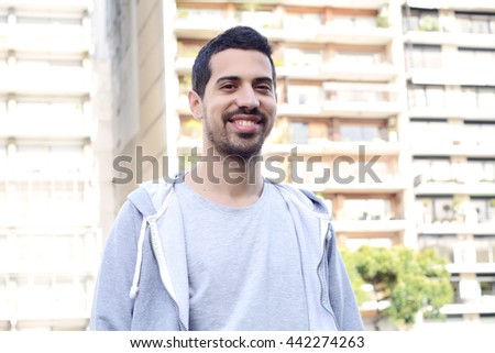 Portrait of young latin man. Urban scene. Outdoors. #442274263