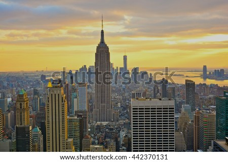 NEW YORK, UNITED STATES - DECEMBER 28, 2015 - landscape of the skyscrapers of New York at sunset with empire state bulding views #442370131
