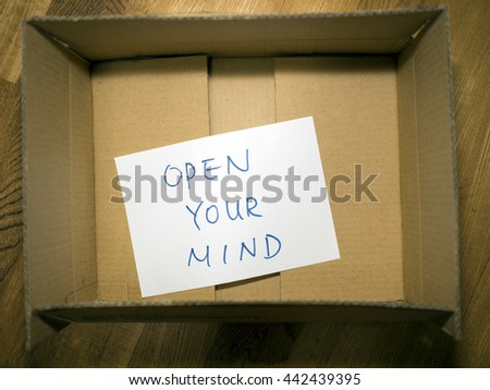 paper Note in paper box Open Your Mind Concept #442439395