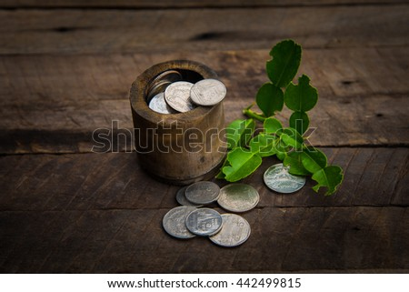 Coins in a brown wooden barrel #442499815