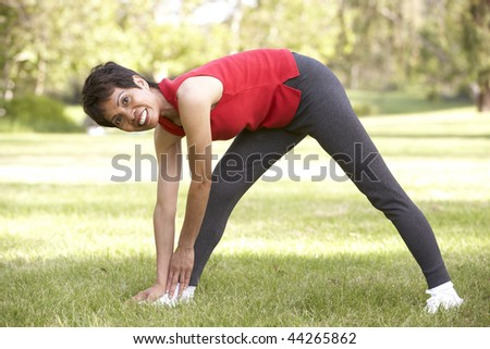 Senior Woman Exercising In Park #44265862