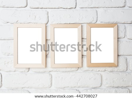 blank black picture frame on the wall
