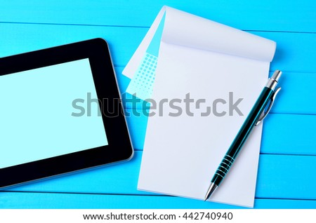 Notepad with pen and tablet pc on wooden table #442740940
