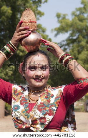 AMRAVATI,MAHARASHTRA, INDIA - NOV 08 : Unidentified Beautiful young girls dressed as tribal women for dance on occasion of the Hindu religious festival, Amravati, Maharashtra,India, 8 November 2014. #442781116