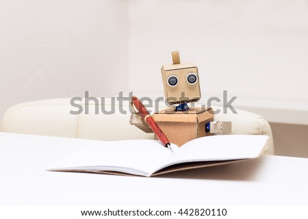 Robot writes with a ballpoint pen and sitting at the table #442820110
