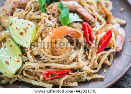 Thai fried rice noodles with shrimps #442821730