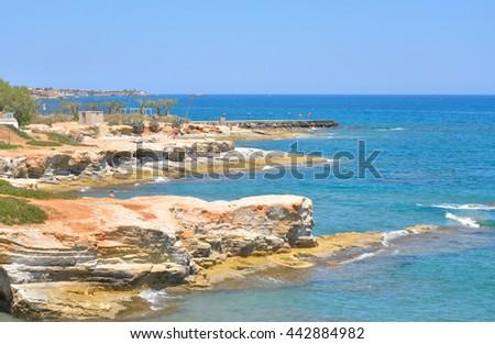 Rocks on the coast of Cretan Sea near Hersonissos, Crete, Greece. #442884982